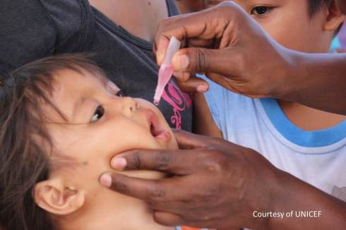 Child receiving vaccine courtesy of UNICEF - Copy